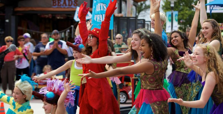 Arts A'Fair performers smiling and bowing