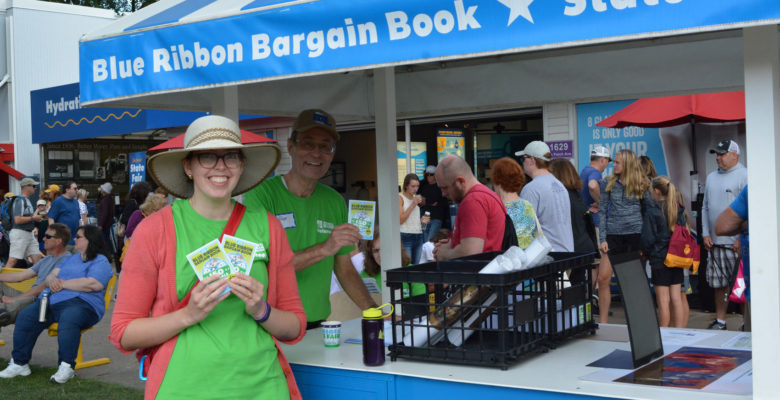 Volunteers selling Blue Ribbon Bargain Books during the fair