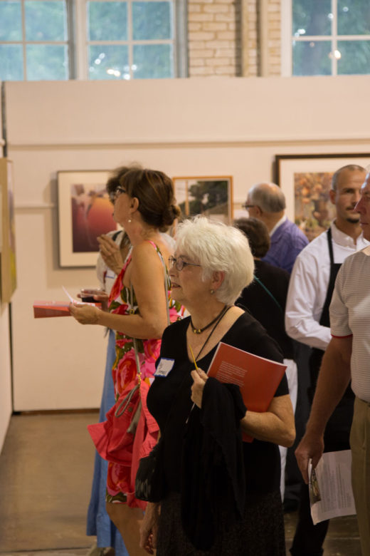 First Glance guests looking at fine art