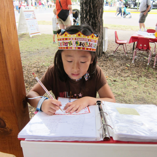 Little Girl wearing Alphabet Forest crown