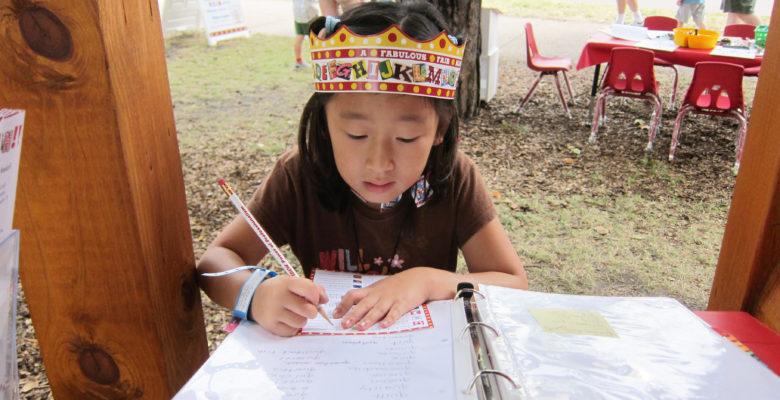 Little Girl wearing Alphabet Forest crown
